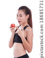 Fitness woman holding apple  18685731