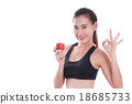 woman holding apple and showing ok sign 18685733