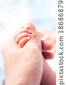 holding a hand of the newborn child tenderness 18686879