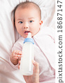 feeding newborn infant with feeding milk bottle 18687147