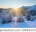 Sunrise winter mountain landscape with fir trees. 18689234