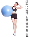 Young woman doing exercises with fitness ball  18690893