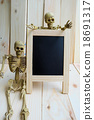 Welcome sign blackboard with a couple of skeletons 18691317