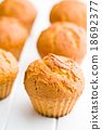 sweet muffins on kitchen table 18692377