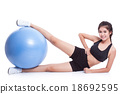 Young woman doing exercises with fitness ball  18692595