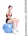 woman sport training with exercise ball 18692899