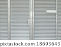 Steel door closed with white mail box 18693643