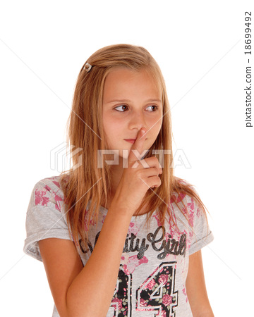Young pretty girl with finger over mouth. 18699492