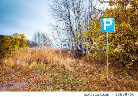 Empty parking lot with roadsign in countryside 18699756