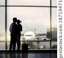 sweethearts in airport 18719473