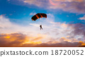 Skydiver On Colorful Parachute In Sunny Sunset 18720052