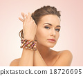woman wearing bracelet with beads 18726695