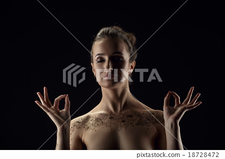 Yoga. Nude woman meditating, her hands in mudra 18728472