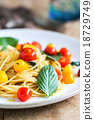 Spaghetti with red and yellow cherry tomato 18729749