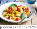 Spaghetti with red and yellow cherry tomato 18729750
