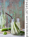 glass jars of cucumber and rosemary 18734941