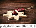 wooden christmas star on a rustic wooden surface 18736010