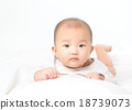Asian baby lying on stomach. looking 18739073