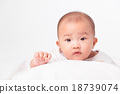 Asian baby lying on stomach. looking 18739074