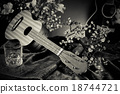 Still life with Ukulele flowers and guitar. 18744721