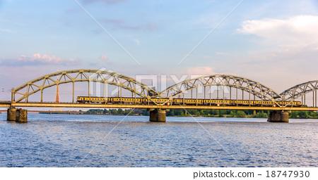 Train on a bridge in Riga, Latvia 18747930