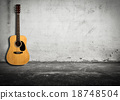 Acoustic guitar against old wall 18748504