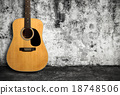 Acoustic guitar against old wall 18748506