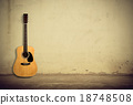 Acoustic guitar against old wall 18748508