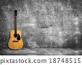 Acoustic guitar against old wall 18748515