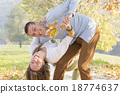 Happy couple in the park having fun in the park 18774637
