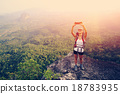 woman hiker taking photo with smart phone   18783935