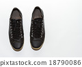 Black sneakers on white background. 18790086