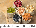 Different kinds of beans in sacks bag on wooden 18807964