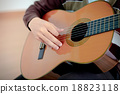 Practicing in playing guitar. Handsome young men playing guitar 18823118