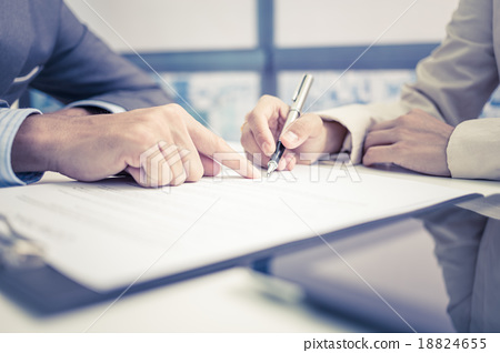 Stock Photo: Female hand signing contract.
