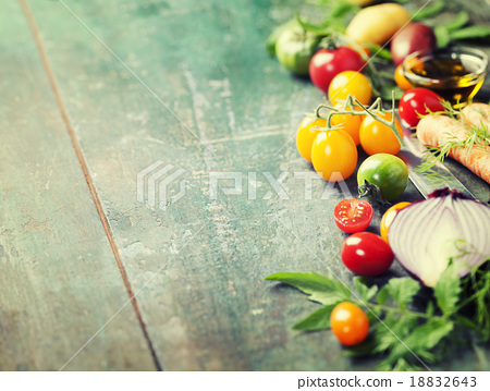 Stock Photo: Vegetables on wood.