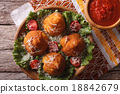 Arancini rice balls and tomato sauce top view 18842679