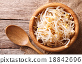 sprouts of mung beans in a wooden bowl top view 18842696