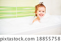 happy child girl bathes in  bath with foam and bubbles 18855758