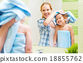happy family in bathroom. mother of a child with towel dry hair 18855762