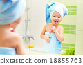 funny little girl cleans teeth with toothbrush in bathroom 18855763