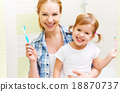 family mother and daughter child brushing teeth  18870737
