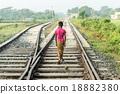 a little boy walking on railway 18882380