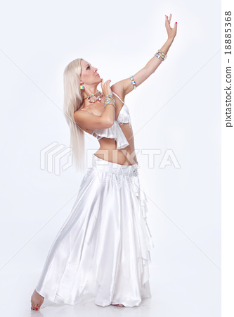 Belly  dancer in a white dress. 18885368