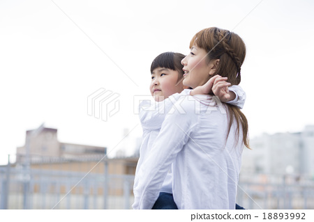 A mother holding a child 18893992