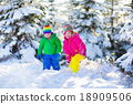 Children playing in snowy winter park 18909506