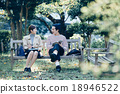 A couple sitting on a bench 18946522