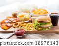 close up of fast food snacks and drink on table 18976143