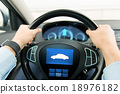 close up of man driving car with icon on computer 18976182