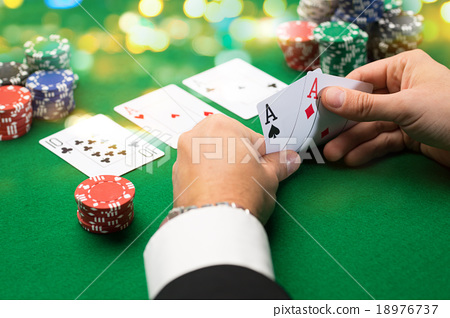 Stock Photo: poker player with cards and chips at casino